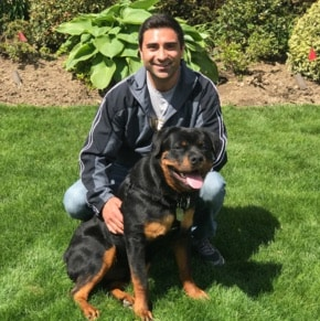 Rotweiller with Anthony. Dog body language shows relaxed posture.